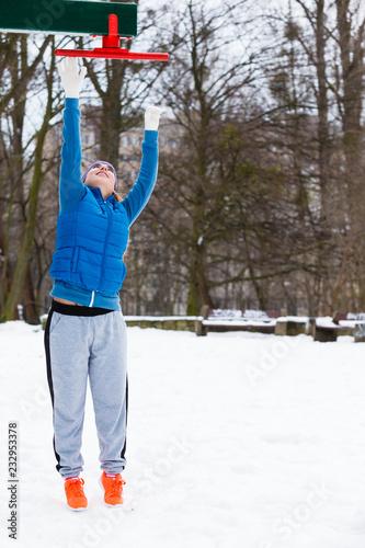 Sticker Woman wearing sportswear urban exercising outside during winter