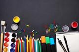 Back to school. School supplies on blackboard background. - 232958345