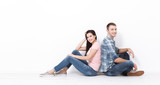 Happy young couple sitting on floor looking up while dreaming their new home and furnishing. Mock up - 232961999