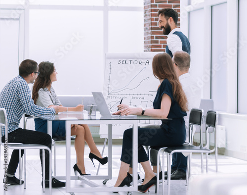 Wall mural business team holds a meeting in a modern office