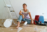women in the room with white wall and painting equipment - 232972779