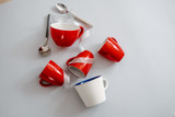Christmas tree made of red coffee cups and spoons. Creative flat lay, minimalism concept - 232980742