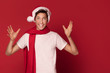 Happy teenager boy in Santa Claus hat.