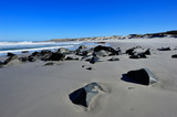 Rocks on the beach and Atlantic ocean in the Namaqualand National Park - 232985969