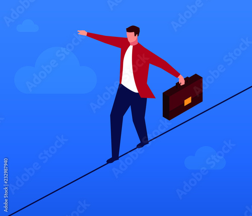 Businessman walking a wire rope