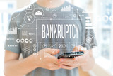 Bankruptcy with young man using a smartphone - 232994191