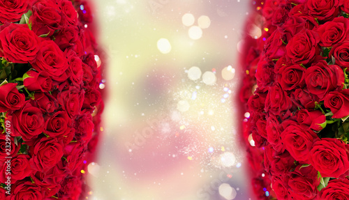 Bouquet of fresh dark red rose buds with over bokeh fesive background frame
