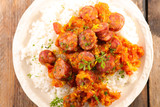sausage with spicy sauce and rice - 232998525