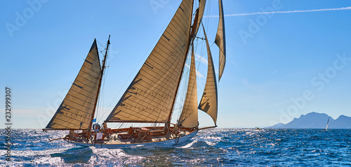 Sailboat under white sails at the regatta. Sailing yacht race