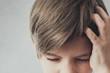 Portrait of boy with headache
