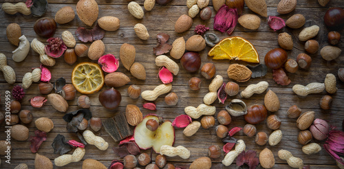 Wall mural dried fruits andflowers background