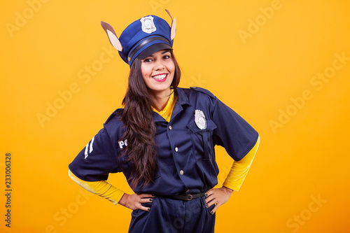 Delightful Beautiful Young Woman Wearing Police Costume Over Yellow Background. Having  Fun.