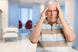 Mature man having headache on  background - 233008764