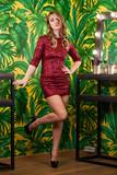 Portrait of beautiful blonde woman in red dress - 233015993