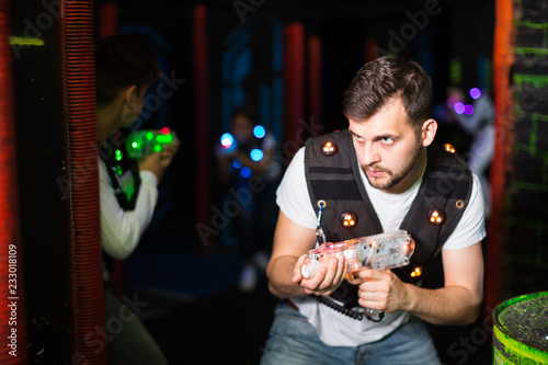 Foto Murales Excited guy during lasertag game
