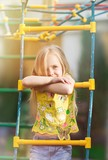 Girl playing on playground in city park - 233020789
