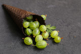fresh organic gooseberry berries on a black background - 233020973