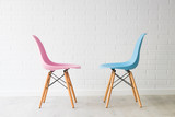 pair of chairs in pink and blue, equality concept - 233021125