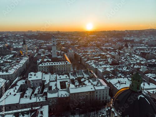 Foto Murales beauty sunset over old european city. birds eye view