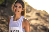 Female runner competing in mountain trail race
