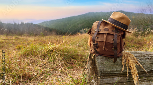 Leinwanddruck Bild Looking image of travelling concept, backpack and hat . Vacation in mountains.