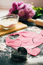 """Постер, картина, фотообои """"Baking concept for St. Valentines Day with heartshaped cutters and pink cookies on the dark table. Valentines day. Homemade pink heart cookies."""""""