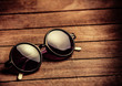 Retro sunglasses on wooden table. Side view - 233040164