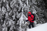 Hiker makes his way on snowy slope