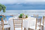 Exterior Ocean Front Table set for Dinner - 233059535