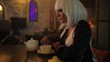 Sexy unusual blonde woman drinking tea in a bar