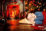 boy was sleeping by fireplace - 233061176