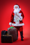 santa claus with suitcases - 233061516