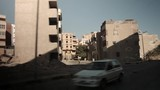 Driving through devastated urban area in Hurghada, Egypt - 233063309