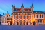Scenic cityscape with the picturesque night medieval Christmas Burg Square in Bruges, Belgium