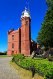 Ustka, Pomerania, Poland - Historic lighthouse building at the Baltic Sea shoreline and Slupia river in Ustka - 233074395