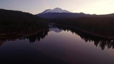 Aerial View of Snow-Covered Mountain over Peaceful Lake at Dawn - Mt. Shasta & Lake Siskiyou, California - 233078700