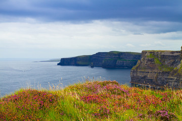 Photo of beautiful scenic sea and mountain landscape. Cliffs of Moher, west coast of Ireland, Atlantic ocean. View of ocean scenery © freeskyline