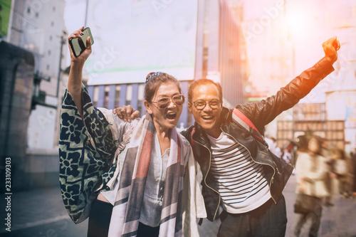 Foto Murales couples of asian traveller happiness emotion at dotonbori most popular traveling destination in osaka japan