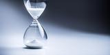 Modern hourglass in running time in studio lights - 233119504