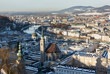 panoramic winter view of the historic center of Salzburg Austria surrounded by the Alps covered with snow in a foggy haze - 233121557