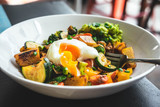Roasted veggies salad, pumpkin, zucchini, broccoli with avocado and poached egg. Healthy eating, food photography concept. - 233123382