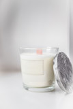 Concrete scented soy round candle on grey table - 233123782