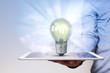 Leinwanddruck Bild - Man Hand Tablet PC Idea Bulb