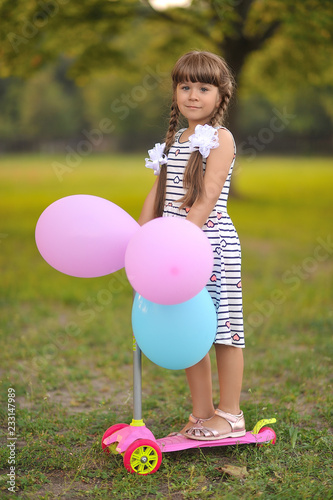Cute girl with color balloons