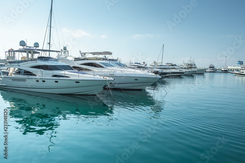 small boats and yachts are in the berth of the seaport of Sochi on the Black sea bright sunny summer day