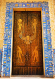 Egyptian hieroglyphs on the door. Hieroglyphic carvings on the exterior walls of an ancient egyptian temple