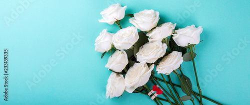 Flower White Rosas on the Colorful Background Holiday Natural Valentine's Day Gift with Love Heart Shape Flat Lay Top View Copy space for text Toned image Banner