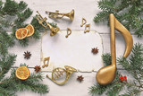 Christmas tree with music note , paper , trumpet on wooden background