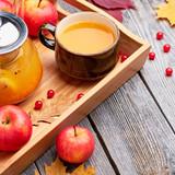 Hot sea buckthorn tea drink with apples.  Hot autumn beverage - 233208793