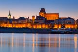 Old town of Torun at night reflected in Vistula river, Poland - 233211948